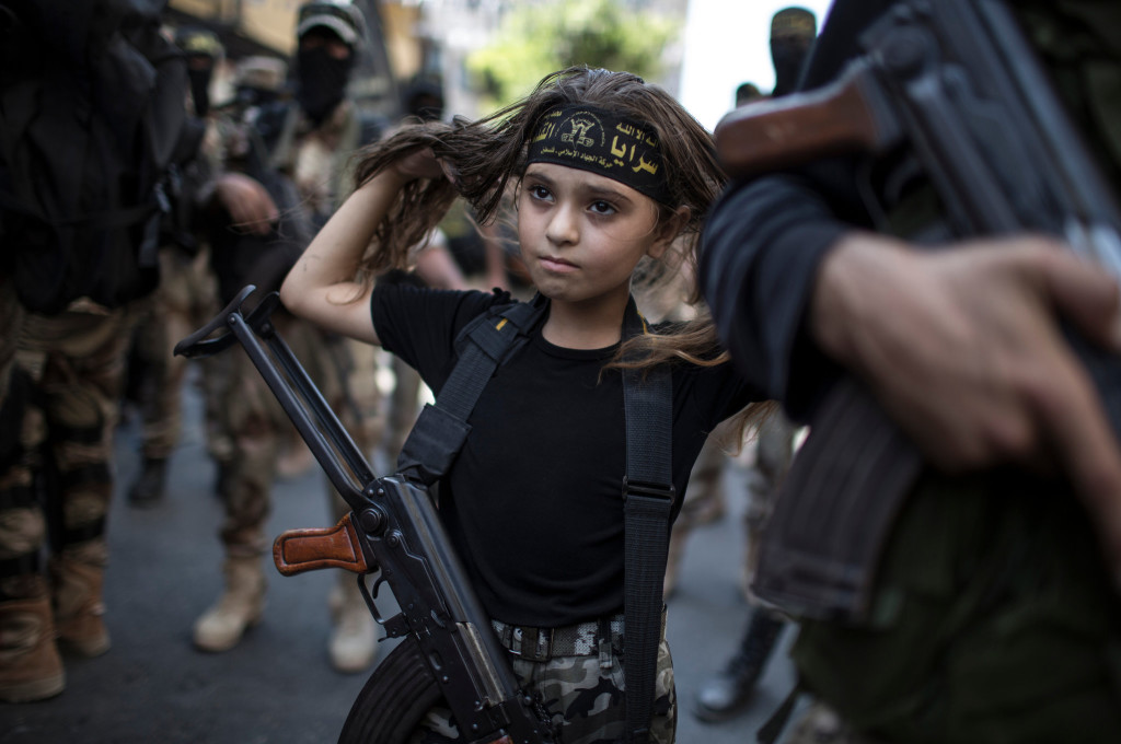 Palestinian girl with Kalashnikov rifle